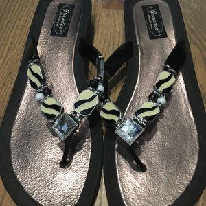 2 pairs of fancy flip flops